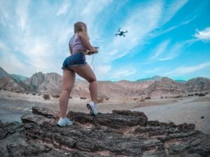 What Is The Easiest Drone To Fly? Woman Flying A Drone